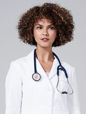 woman clinician wearing a lab coat and a stethoscope